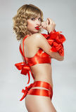 woman bound with red gift ribbon Royalty Free Stock Images