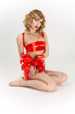 Woman bound with red gift ribbon. Woman bound with red ribbon royalty free stock photography