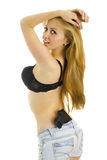 Sexy woman in bra with a gun in her pants. Stock Image