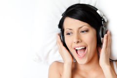Sexy woman in brassiere listens to music Stock Image