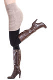 Sexy woman in brown boots - moving up Stock Photography
