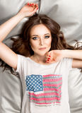 Sexy woman brunette woman in shirt with American flag Stock Photography