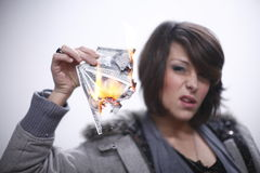 woman burning money Royalty Free Stock Photos