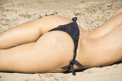 Sexy woman buttocks on the beach Royalty Free Stock Photos