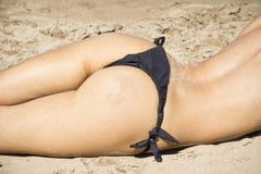 Sexy woman buttocks on the beach Royalty Free Stock Photos