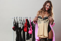 Sexy woman buyer in shop with lingerie. Stock Photos