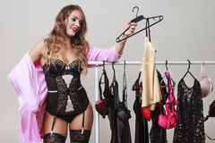 Sexy woman buyer in shop with lingerie. Royalty Free Stock Photo