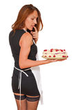 Sexy woman with cake. Sexy young woman in stockings holding cake Royalty Free Stock Image