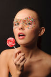 Sexy woman with candy mask on face Stock Photos