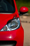 Sexy woman car. Red lady car with eyelash over front headlight Royalty Free Stock Images