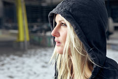 Sexy woman in cardigan. Sexy woman wearing a hooded cardigan outside in urban enviroment Stock Photo