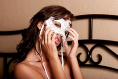 Sexy woman in carnival mask Stock Images