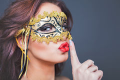 Sexy woman with carnival mask Stock Image