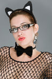 woman with cat ears on grey background Royalty Free Stock Image