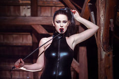 Sexy woman in catsuit with whip Royalty Free Stock Image