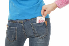 Sexy woman with a cell phone in her back pocket Royalty Free Stock Photos