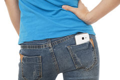 Sexy woman with a cell phone in her back pocket. On a white background Stock Images