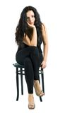 Sexy woman on the chair Stock Photography