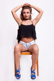 Sexy woman on a chair Royalty Free Stock Image