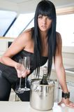 woman with champagne bottle in new year party Royalty Free Stock Photography
