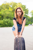woman changing wheel on a roadside stock photos