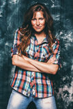 Sexy woman in check shirt. In studio Royalty Free Stock Photos
