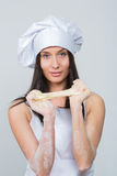 Sexy woman in chef uniform knead the dough Royalty Free Stock Image