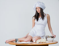 Sexy woman in chef uniform knead the dough Royalty Free Stock Photo