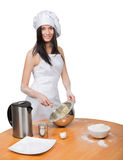 Sexy woman in chef uniform knead the dough Stock Photo