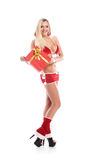 A sexy woman in Christmas lingerie holding a present Royalty Free Stock Photos