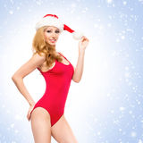 A sexy woman in Christmas lingerie on a snowy background Royalty Free Stock Photos