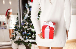 Sexy woman with a Christmas present in her hand. Stock Photo