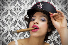 Sexy woman with cigar Royalty Free Stock Image