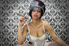 Sexy woman with cigar Stock Photo