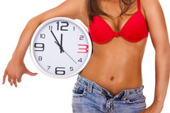 Sexy woman with clock Royalty Free Stock Images