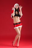 Sexy woman in the clothes of Santa Claus with Christmas candy Stock Photo
