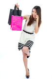 Sexy woman with colorful gift shopping bags Royalty Free Stock Image