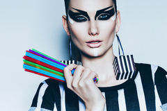 Sexy woman with colourful drinking straws Stock Images