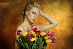 Sexy woman with colourful flowers Stock Photo