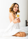 Sexy woman with condom in bed Royalty Free Stock Photos