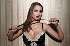 Sexy woman in corset with whip Stock Image