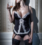 Sexy woman in corset with whiskey closeup Royalty Free Stock Images