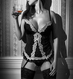 Sexy woman in corset with whiskey selective coloring Stock Photos