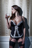 Sexy woman in corset with whiskey Royalty Free Stock Photo