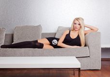 Sexy woman on couch Stock Photos