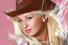 Woman with cowboy hat. On pink background Royalty Free Stock Images