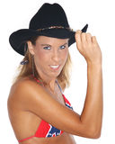 Sexy woman in cowboy hat. Wearing confederate flag bikini, white background Royalty Free Stock Photos
