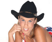 Sexy woman in cowboy hat. Portrait of sexy young woman in bikini and cowboy hat, white background Stock Photo