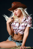 Sexy woman with cowboy hat. On black background Stock Photos