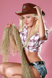 Sexy woman with cowboy hat. On pink background Royalty Free Stock Photos